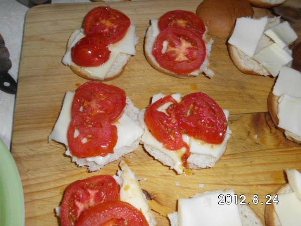 I placed the hot tomato on the bun, and added some cheese.