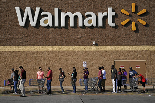 Cleaning up: Customers queue outside a Walmart store in Port Arthur, Texas. Picture: REUTERS