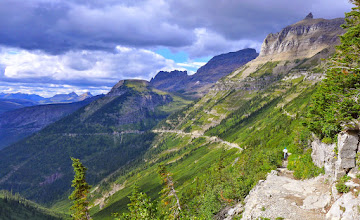 Photo: The Highline Trail is located between the Garden Wall (Continental Divide) and the Going to the Sun Road. Mardi is approaching Logan Pass and the end of the trail. Bishop's Cap can be seen on the horizon in the upper right.