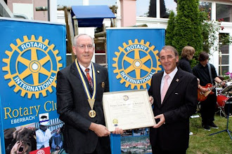 Photo: Werner Kley, 2010-2011 President of the Rotary Club of Eberbach,  with Klaus, who just finshed an accomplished year as his Club's President! They are holding the Club's charter.