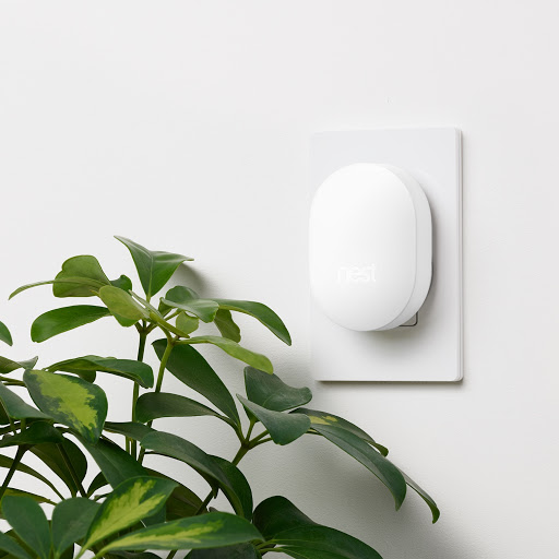Nest Connect signal range extender for Nest Secure system plugged into home wall socket
