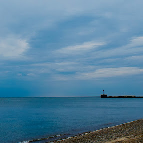 Lighthouse by Jay Hathaway - Landscapes Beaches ( lighthouse, beach, clouds, lake, water )