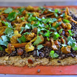 Cauliflower Crust Pizza with Black Mung Bean Curry.