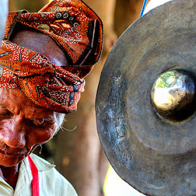 Gamelan Player by Marcell Boli - People Portraits of Men ( face )