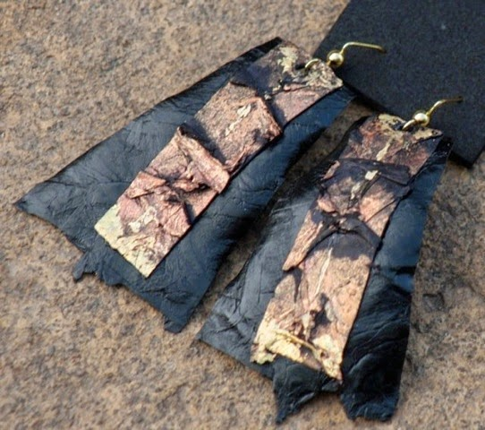 Photo: Black glazed fish leather earrings from sample selection, highlighted with a strip of painted & glittered fish leather.Lyris Tracey, Island Mantra, Antigua