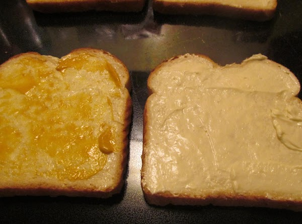 Place two slices of bread on a clean working surface. Put a thin layer...