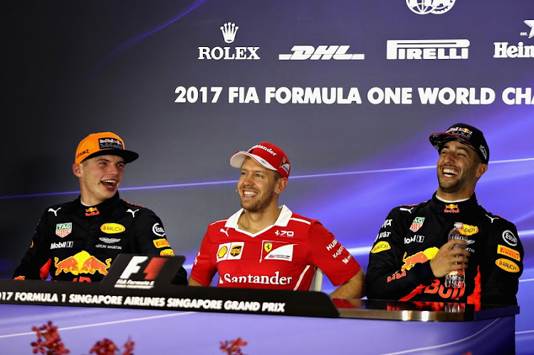 Top three qualifiers Sebastian Vettel of Germany and Ferrari, Max Verstappen of Netherlands and Red Bull Racing and Daniel Ricciardo of Australia and Red Bull Racing in the post qualifying press conference after qualifying for the Formula One Grand Prix of Singapore at Marina Bay Street Circuit on September 16, 2017 in Singapore.