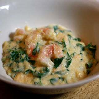 Shrimp and Grits with Arugula.