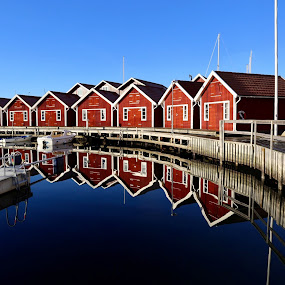 Nice holiday homes Sweden by Eva Larsson - Buildings & Architecture Other Exteriors ( water, sweden, december, houses, blue sky, colorful, bridge, seaside, relaxing, reflecting, wood houses, coast, stillness, bath huts )