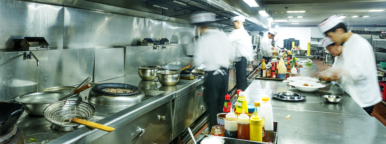 industrial kitchen, with chefs making food