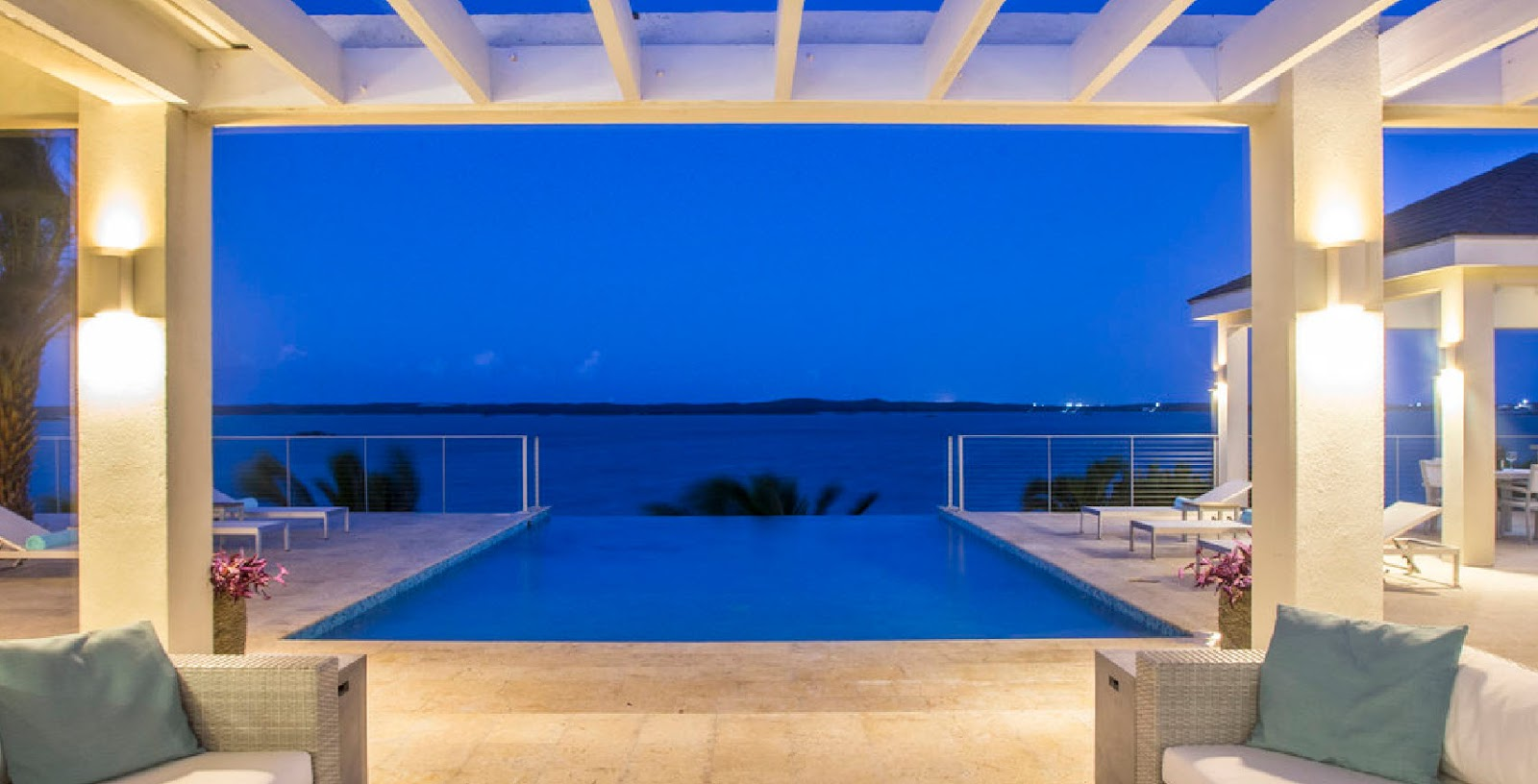 Infinity-edge pool with cable railings and ocean view