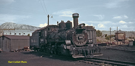 Photo: 074-23.  K-27 #464 stored in abandoned condition on a roundhouse turntable spur.  It had been the Durango switcher a few years earlier.  7/25/60.