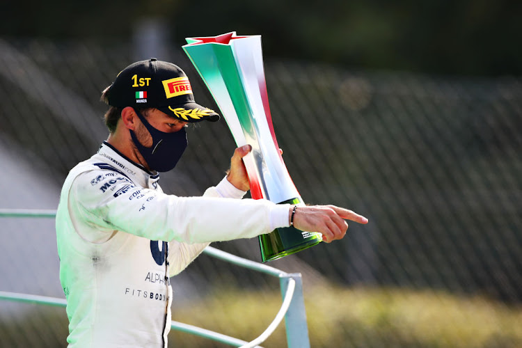 Race winner Pierre Gasly of France and Scuderia AlphaTauri celebrates on the podium during the F1 Grand Prix of Italy at Autodromo di Monza on September 6 2020 in Monza.