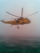 """Photo: 27 July 08 RAF Air Sea Rescue helicopter """"Rescue 131"""" winches one of the casualties aboard from Tynemouth RNLI all weather lifeboat during the rescue of two men whose boat """"Drowning Rat"""" had sunk off Tynemouth."""