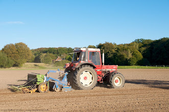 Photo: Hobby farmer raking the soik of his field near Petershagen in East-Westphalia.