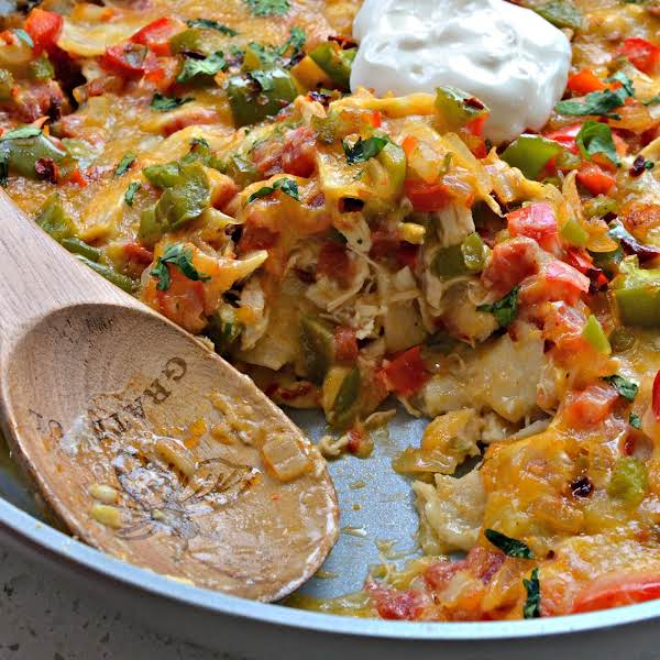 King Ranch Chicken Is A Fun Family Recipe Full Of Shredded Chicken, Corn Tortillas, Onions, Bell Peppers, Garlic, Jalapenos And Tomatoes In A Creamy Chicken Sauce And Topped With Cheddar Jack Cheese.