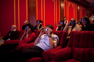 Photo: President Barack Obama and First Lady Michelle Obama wear 3-D glasses while watching Super Bowl 43, Arizona Cardinals vs. Pittsburgh Steelers, at a Super Bowl Party in the family theater of the White House. Guests included family,  friends, staff members and bipartisan members of Congress, 2/1/09. Official White House Photo by Pete Souza