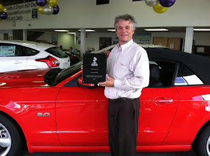 Photo: At Drum Hill Ford handing off a 25 year achievement plaque!