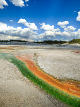 """Photo: Magnetic Anomaly in Yellowstone on the Solstice  The picture here was taken on the summer solstice in thin-crusted geothermal hotbed of the Norris Geysers.  This particular place was not too far from something called the """"whirlygig"""" (or somesuch).  The various colors are made from two merging rivers, each one with a dramatically different temperature.  Different color bacteria live in each temperature of water - the red bacteria was over 160 degrees  and the green was below 160. If anyone else was there during this same time, they can confirm the quirky nature of these dual rivers running in the same channel! :)  from the blog at www.stuckincustoms.com"""