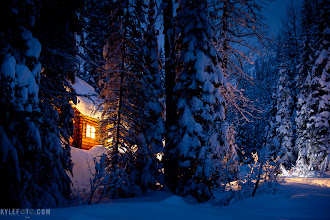 "Photo: Wheeler hut marshmallow land From the holiday collection http://www.kylefoto.com B.C. Canada  Wheeler hut is one of the most accessible alpine huts in B.C. Canada. That being said it was covered enough of the legendary marshmallowy winter powder to get me to sink to my chest. There was no hope of me getting far enough outside the hut to get a photo without my skis on. Setting up my tripod to get this 30 second exposure was also a challenge, as my poles kept sinking in the snow. The warm glow of the hut windows are welcoming as the final minutes of the ""blue hour"" past sunset wained into darkness.  Canon 5D Mark II 30s f/2.8 ISO800 50mm   This print and all of my prints are now 50% off with the coupon code WELOVEWINTER at http://kylefoto.smugmug.com/   Sorry for the ad, but people keep asking about holiday sales, might as well tell them!"