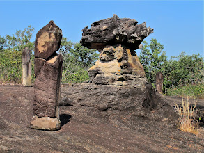 Photo: boundary markers surrounding rocks used as sacred temple spaces