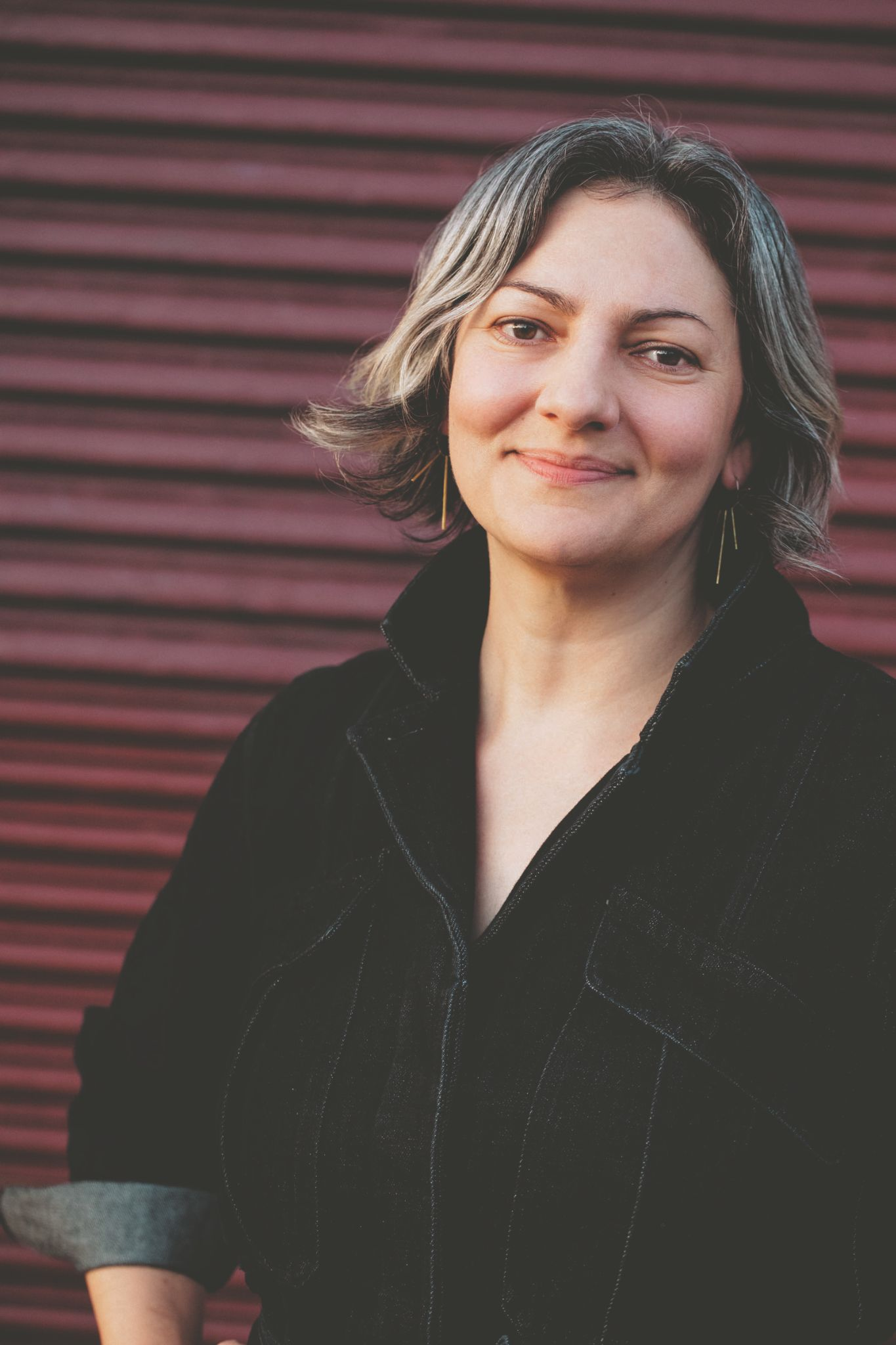 A headshot of Sarah Stein Greenberg.