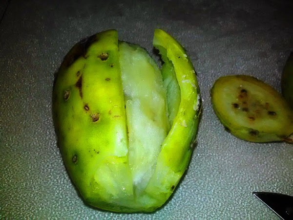 Cut the top and bottom of the pear and make an incision along the...