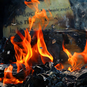 Burning News by Glenys Lilley - News & Events World Events ( ash, headlines, burning, fire, newspaper )