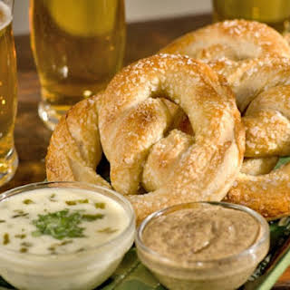 Soft Pretzels with Queso Poblano Sauce and Mustard Sauce.