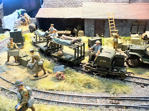 Photo: 008 A mixed scene on Ian Roberts' WW1 layout as casualties arrive from the front line, to be handed over to the motor ambulance for transportation to a field hospital in the rear. Meanwhile some soldiers are getting ammunition boxes ready to be taken back to the front by the same train .