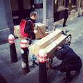 Cargo bike couriers loading large parcel delivery in London