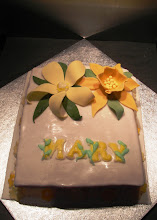Photo: Nana's flowery cake - Vanilla sponge cake decorated with fondant and royal icing lettering