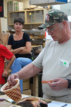 Photo: Bob Grudburg talks about his experiment with laminating the padauk and maple woods together.  He was not happy with the red bleeding into the white.