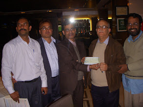 Photo: Mr. Das  circle secretary BSNLCO presenting a cheque Rs. 51000/- to GS