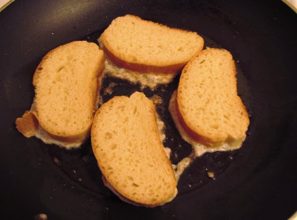 When oil is hot, dip bread slices into batter, turning to coat well. Place...