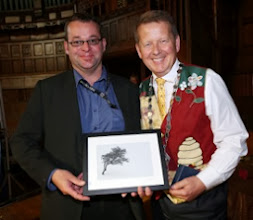 Photo: Colin Kennedy, DCC, receiving his print and paperweight from INIB President Bill Turnbull