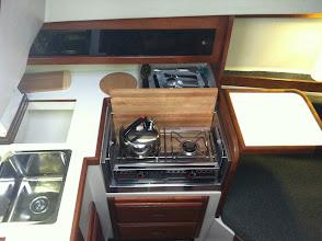 Photo: new origo 3000 stove, collapsable custom made galley table