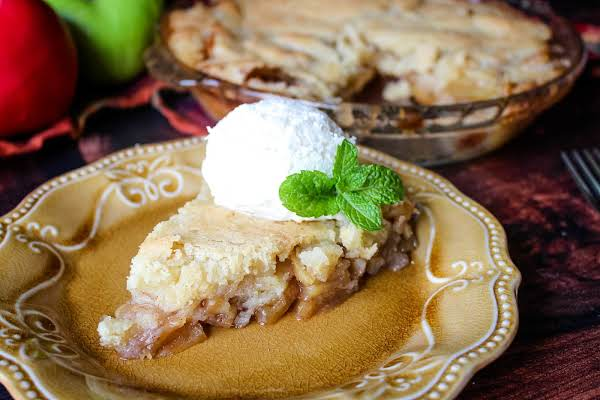A Slice Of Swedish Apple Pie On A Plate.