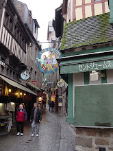 Photo: A single main street, the Grand Rue, defines the town. It is full of shops and eating places, catering now to tourists in much the same way that it did to religious pilgrims for centuries.