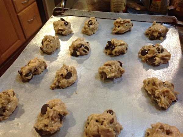 Spray a large cookie sheet with non stick cookie spray, and drop cookie dough...