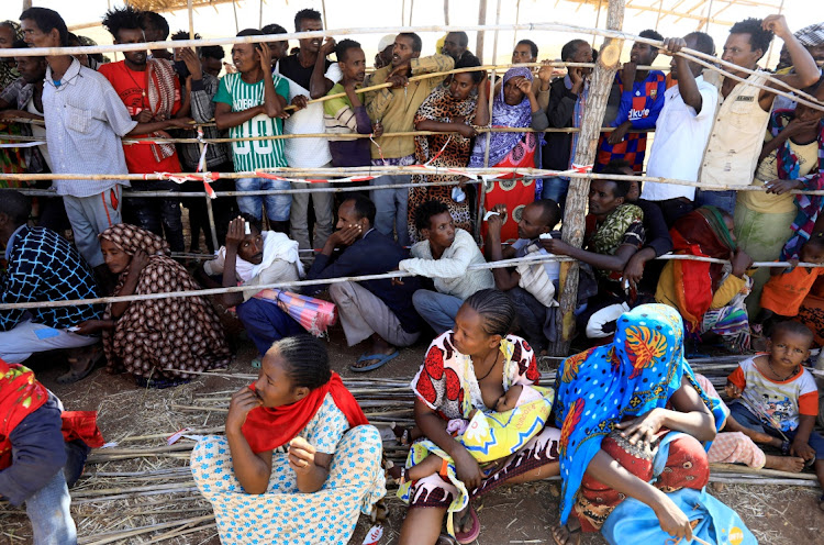 Ethiopians who fled the ongoing fighting in Tigray region gather to receive relief aid at the Um-Rakoba camp on the Sudan-Ethiopia border, in Kassala state in December.