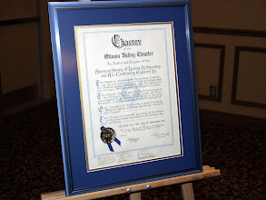 Photo: The original 1952 ASHRAE OVC Charter, with signatures visible at the bottom