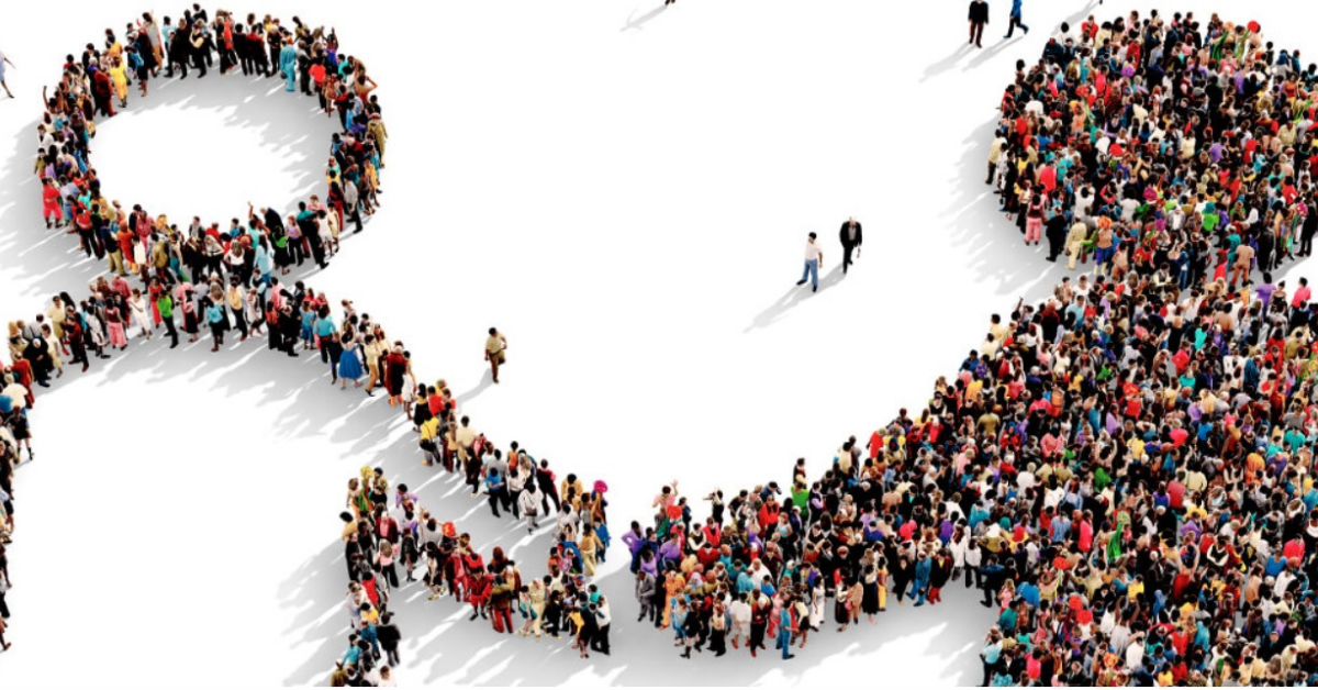 A large group of people forming the image of two characters shaking hands