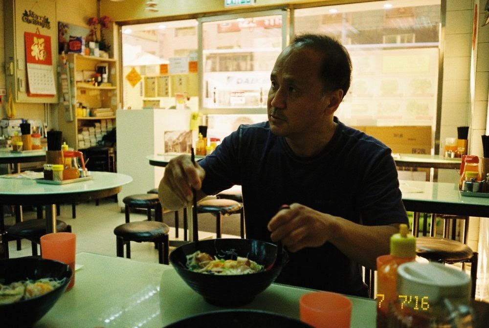 Dad eating noodles in HK