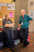 Photo: Dru talking with a conference attendee