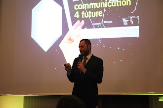 "Photo: Philippe Borremans, presenting the C4F award for ""Best tweet - WCF 2012"""