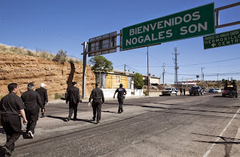 Photo: A group of U.S. bishops makes their way to the Aid Center for Deported Migrants in Nogales, Mexico, March 31. The center, run by the Kino Border Initiative, was one stop a group of U.S. bishops made during a two-day tour of the border area near Nogales. They used the opportunity to again appeal for changes in the U.S. immigration system. (CNS photo/Nancy Wiechec) (April 1, 2014)