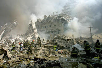 Photo: Rescue personnel scan ground zero for survivors after the twin towers collapsed in New York.