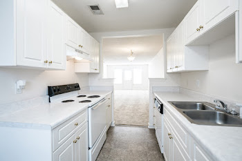 Kitchen with white appliances and white cabinets