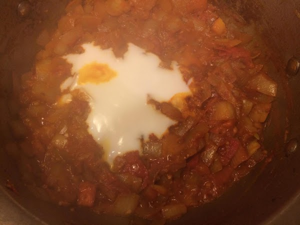 Once it starts boiling, stir in the vegetable mixture and let it simmer for...